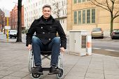 pic of disability  - Portrait Of A Smiling Disabled Man On Wheelchair In City - JPG