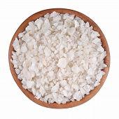 foto of salt-bowl  - Sea salt in a wooden bowl on a white background - JPG