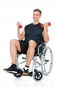 stock photo of handicap  - Handicapped Man On Wheelchair Working Out With Dumbbell Over White Background - JPG