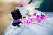 stock photo of top-hat  - Wedding car decoration with black and white top hats - JPG