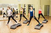 pic of step aerobics  - Group of women making step aerobics in the fitness class - JPG