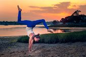 picture of tantric  - Female Model Adho Mukha Vrksasana Variation Handstand Beach - JPG