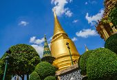 pic of buddhist  - Classic golden buddhist chedi in Great Palace temple in Bangkok - JPG