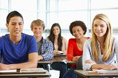 picture of 16 year old  - Multi racial teenage pupils in class - JPG