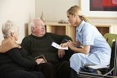 picture of visitation  - Nurse visiting senior couple at home - JPG