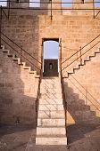 picture of bannister  - Detail take of a staircase climbing to the battlements of a castle - JPG