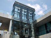 stock photo of elevator  - Modern design transparent glass elevator in an office building - JPG