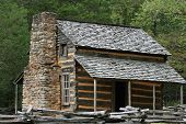 stock photo of split rail fence  - Log Cabin in the smoky mountains with split rail fence and stone chimney - JPG