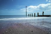 picture of sea-scape  - Shot of a beach on a sunny day looking out to the sea - JPG