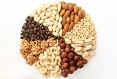 stock photo of hazelnut  - Assorted nuts in the form of a circle  - JPG