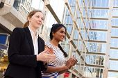 foto of congratulation  - two young ladies congratulating their colleagues on an achievement - JPG