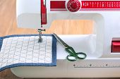 foto of sewing  - Sewing machine and sewing accessories on wooden table - JPG