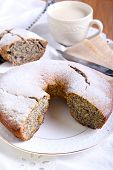 stock photo of icing  - Poppy seed and raisin ring cake with icing sugar on top - JPG