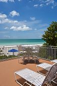 stock photo of gulf mexico  - Large Patio overlooking beach on the Gulf of Mexico - JPG