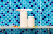 stock photo of pregnancy test  - Pregnancy test with pills on bath shelf on blue background - JPG