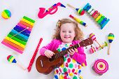 pic of girl toy  - Child with music instruments - JPG