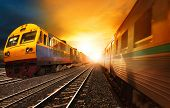 picture of passenger train  - passenger trains and industry container railroads running on railways track against beautiful sun set sky use for land transport and logistic business - JPG