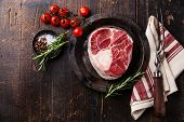 pic of veal  - Raw fresh cross cut veal shank for making Osso Buco and meat fork on dark wooden background - JPG