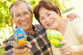 picture of pistols  - Senior couple with water pistols - JPG