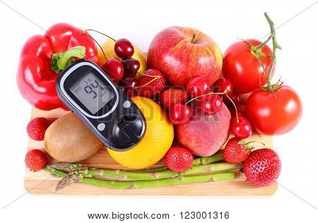 Glucometer with fresh ripe fruits and vegetables concept of diabetes healthy food nutrition and strengthening immunity. White background