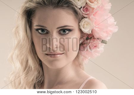 Tender floral beauty portrait of girl with tender roses