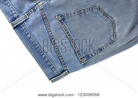 old blue jeans with button on white background