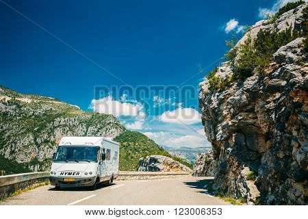 Verdon, France - June 29, 2015: White colour Hymer motorhome car on background of French mountain nature landscape. The Hymer AG is a one of largest manufacturers of motorhomes and caravans in Europe.