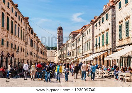 DUBROVNIK, CROATIA - APRIL 11, 2015: Tourists visit the Old Town of Dubrovnik, a UNESCO's World Heritage Site