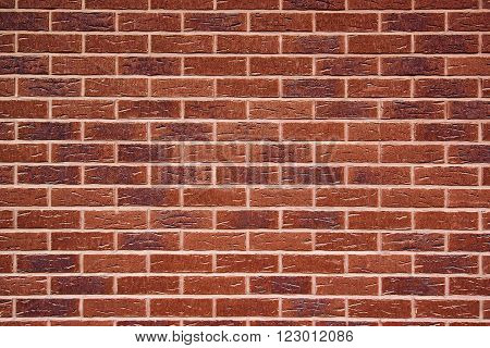 Exposed red vintage brick wall texture brickwork pattern as background