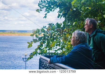 Senior man and woman looking at the river Kama (Tatarstan Russia)