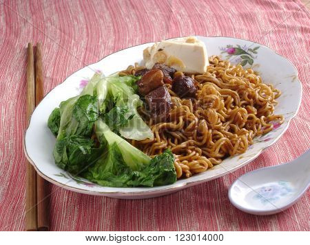 Chinese cuisine. Chow mein with vegetable as lunch.
