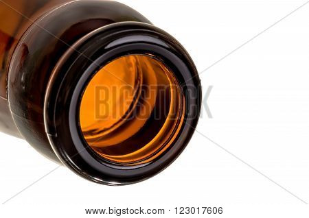 The neck of the brown glass bottle isolated