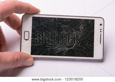 Phone drop to the floor and screen damage broken on white background
