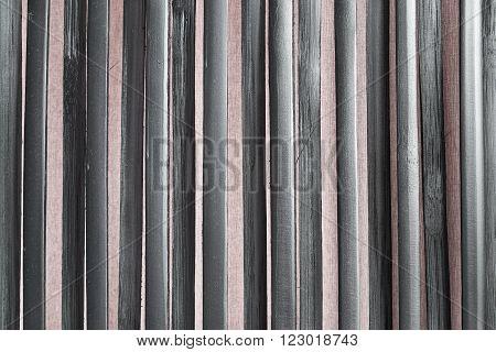 Black rattan fence closeup as a background