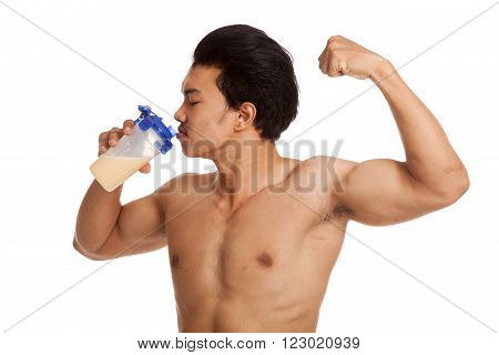Muscular Asian man drinking whey protein flexing biceps  isolated on white background