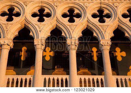 Front view of Dodge Palace in perfect sunrise light show yellow shadow pattern in Venice, Italy