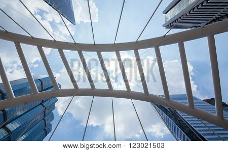 Sathorn Bridge in the daytime sky with clouds downtown Bangkok Thailand.
