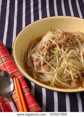 Mung bean sprouts stir fried with minced meat. Served with spoon and chopstick.