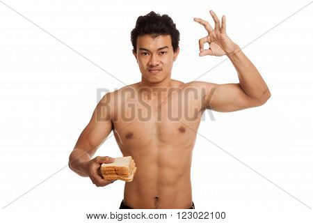 Muscular Asian Man Load Carbs With Some Bread Show Ok