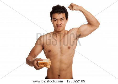 Muscular Asian Man Load Carbs With Some Bread  Flexing Biceps