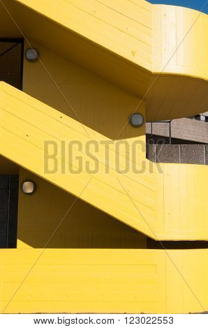 Modern yellow stairway exterior to a carpark