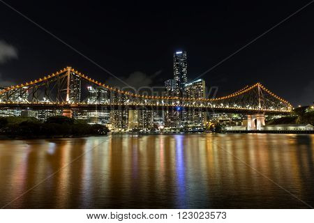 Brisbane Story Bridge and cityscape by night viewed from the New Farm Riverwalk