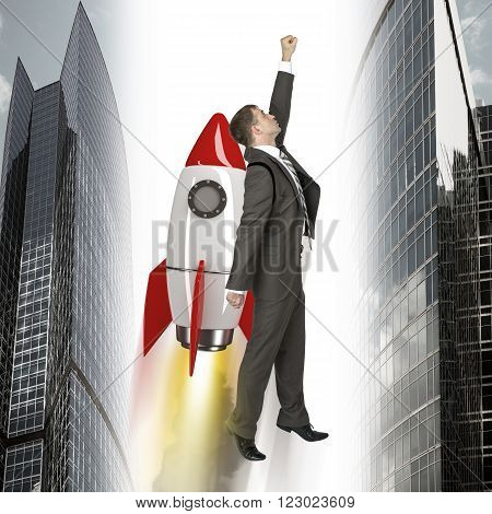 Businessman flying on rocket between two building