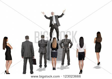 Leader standing on tribune in front of businesss people isolated on white background