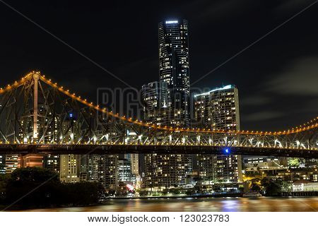 BRISBANE, AUSTRALIA: Brisbane Story Bridge and cityscape closeup by night viewed from the New Farm Riverwalk