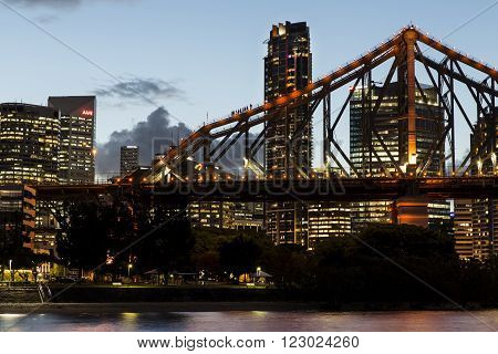 BRISBANE, AUSTRALIA - MARCH 3 2016: Brisbane Cityscape and Story Bridge climbers at sunset.