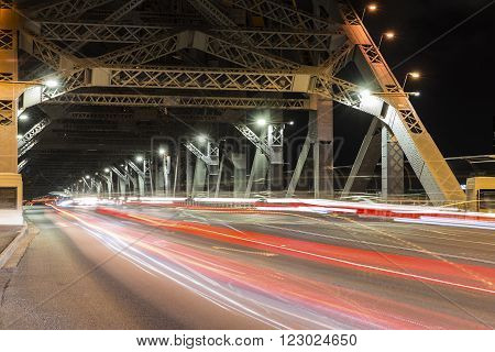 BRISBANE, AUSTRALIA - MARCH 3 2016: Brisbane Story Bridge night traffic. The bridge spans the Brisbane River and carries vehicular, bicycle and pedestrian traffic.