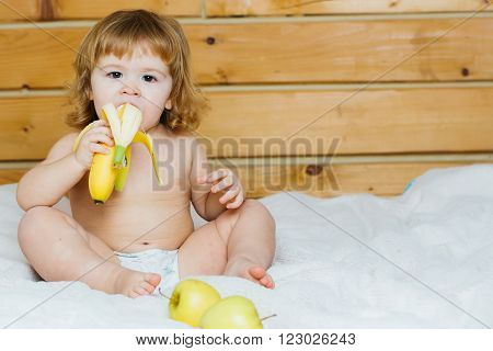 Boy With Banana And Apples
