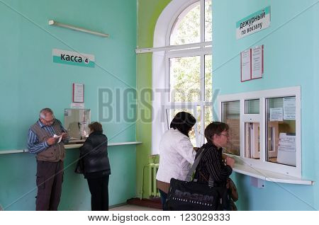 Murmansk, Russia - august 27, 2012, People at the box office selling tickets at the railway station, Murmansk