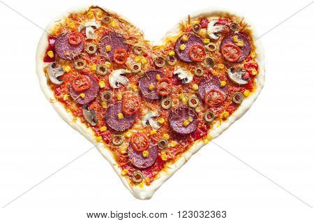 Baked heart-shaped homemade pizza topped with mozzarella and tomato slices with salami pepperoni mushrooms olives and garlic close-up isolated on white background. Decorated for Valentine's Day
